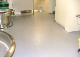 Epoxy restroom floor installation at Norpac Foods