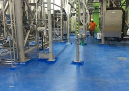 Urethane base with Blue epoxy top coat flooring installation at brewery